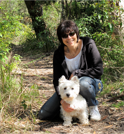 photo of Michelle Corban looking healthy and relaxed out walking with her dog